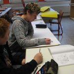 Eine lateinische Zeitung erstellen hier die Schüler unter der Leitung von Frau Schäfer-Johann und Herrn Simon.